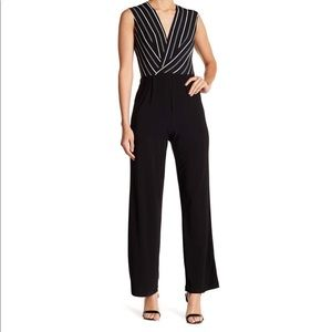 Bebe striped black and white wide leg jumpsuit